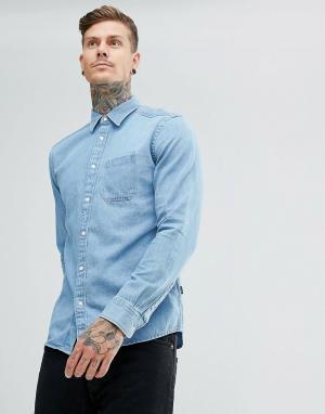 Wrangler Джинсовая рубашка цвета индиго. Цвет: синий