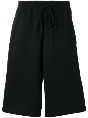 Спортивные шорты Komakino. Цвет: чёрный