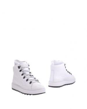 Полусапоги и высокие ботинки PUMA. Цвет: белый