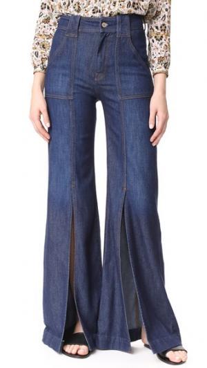Расклешенные брюки с разрезами спереди 7 For All Mankind. Цвет: роскошный домашний темно-синий
