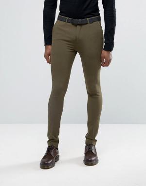 Rogues of London Супероблегающие брюки. Цвет: зеленый