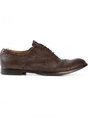 Плетеные броги на шнуровке Officine Creative. Цвет: коричневый