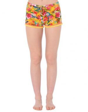 Пляжные брюки и шорты BANANA MOON. Цвет: желтый