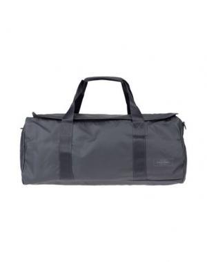 Дорожная сумка EASTPAK. Цвет: свинцово-серый