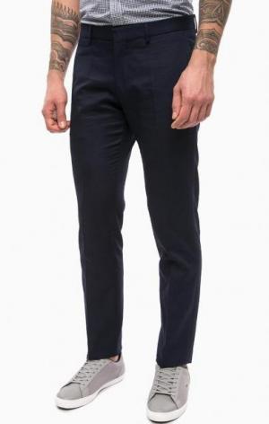 Синие зауженные брюки Lacoste. Цвет: синий
