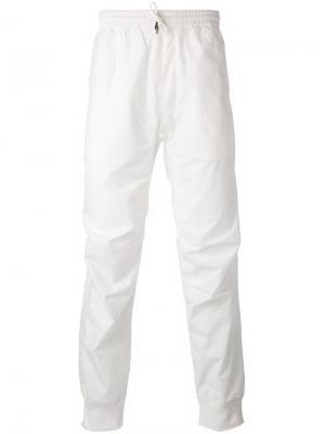 Спортивные брюки с карманом сзади Maharishi. Цвет: белый