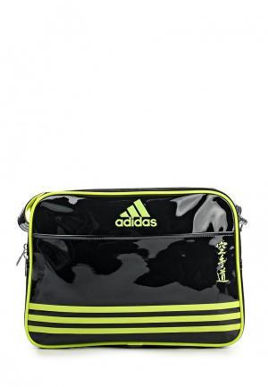 Сумка спортивная adidas Combat. Цвет: черный