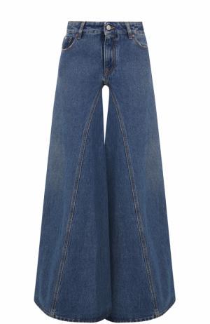 Расклешенные джинсы с потертостями Mm6. Цвет: темно-синий