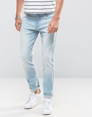 Hollister Голубые рваные зауженные джинсы стретч. Цвет: синий