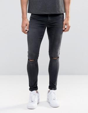 ASOS Черные выбеленные супероблегающие джинсы с рваными коленями. Цвет: черный