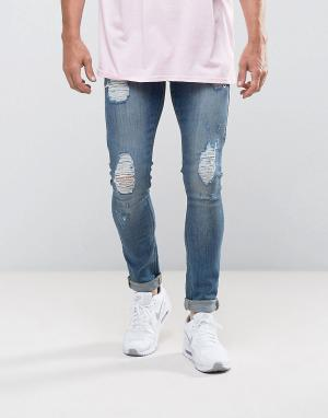 ASOS Светлые супероблегающие джинсы с рваной отделкой. Цвет: синий