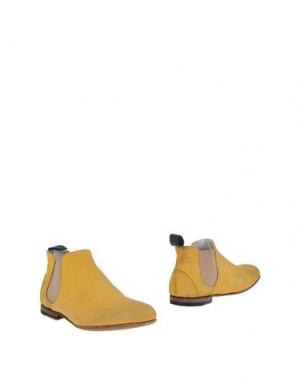 Полусапоги и высокие ботинки ALBERTO GUARDIANI. Цвет: желтый