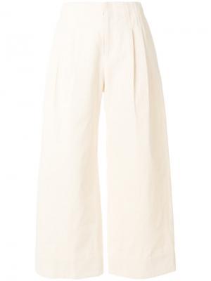 Широкие брюки со складками Nomia. Цвет: телесный