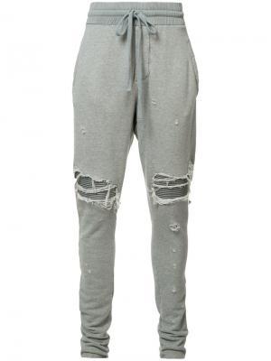 Спортивные брюки с рваными деталями Amiri. Цвет: серый