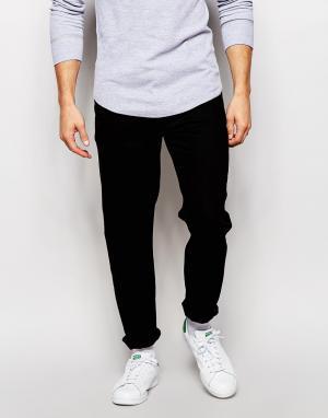 ASOS Черные суженные книзу джинсы. Цвет: черный