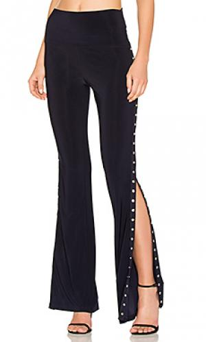 Расклешенные брюки с застёжкой на кнопки по бокам Norma Kamali. Цвет: синий