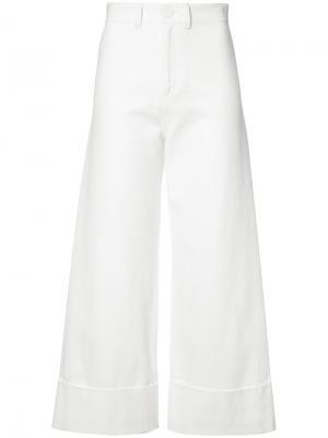 Расклешенные брюки Sea. Цвет: белый