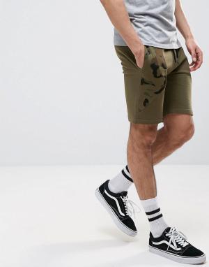 ASOS Трикотажные шорты зауженного кроя с камуфляжными вставками. Цвет: зеленый