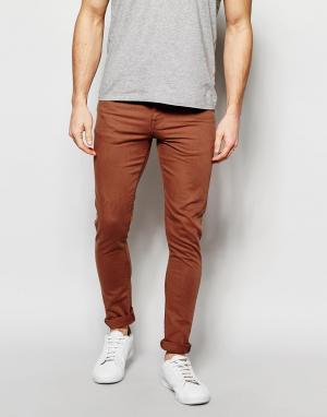 ASOS Супероблегающие джинсы цвета ржавчины. Цвет: коричневый