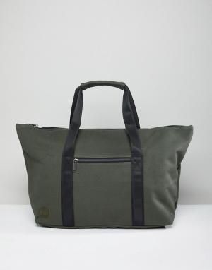 Mi-Pac Парусиновая дорожная сумка цвета хаки Carryall. Цвет: зеленый