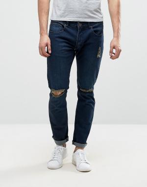 Liquor N Poker Узкие джинсы темного цвета индиго с рваной отделкой. Цвет: темно-синий