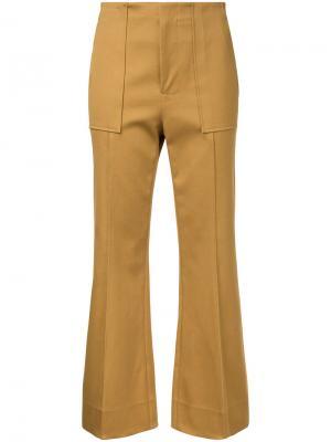 Укороченные брюки клеш Bassike. Цвет: коричневый