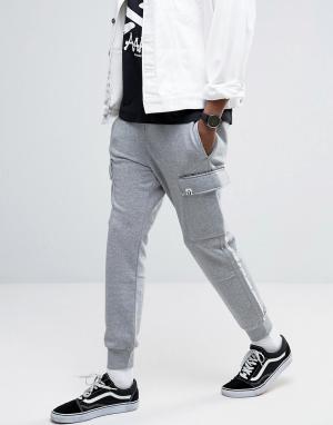 AAPE BY A BATHING APE Джоггеры с принтом на карманах. Цвет: серый