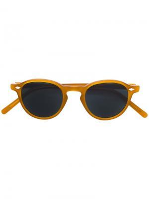 Солнцезащитные очки в круглой оправе Lesca. Цвет: жёлтый и оранжевый