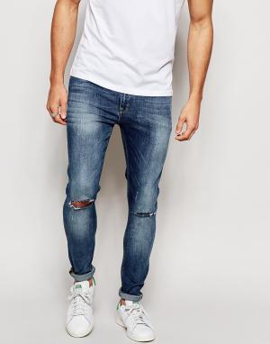ASOS Ультразауженные джинсы скинни с рваными коленями. Цвет: синий