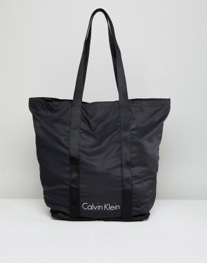 Calvin Klein Черная складываемая сумка. Цвет: черный
