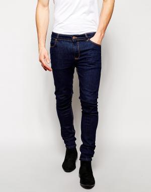 ASOS Супероблегающие джинсы. Цвет: синий
