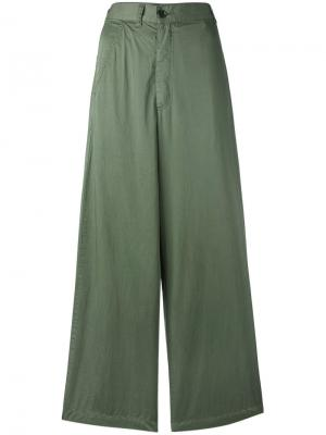 Расклешенные брюки Zucca. Цвет: зелёный