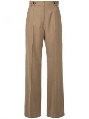 Расклешенные брюки Cyclas. Цвет: коричневый