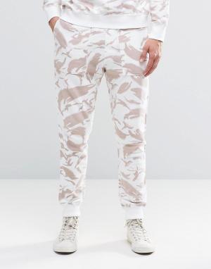 Maharishi Трикотажные штаны в рубчик с камуфляжным принтом. Цвет: бежевый