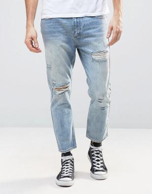 Rollas Укороченные джинсы слим с рваной отделкой и заплатками Stubs. Цвет: синий