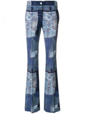 Джинсовые брюки клеш в стиле пэчворк Moschino. Цвет: синий