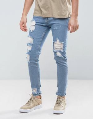 ASOS Голубые джинсы скинни с рваной отделкой. Цвет: синий