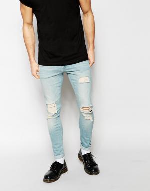 ASOS Супероблегающие рваные джинсы. Цвет: синий