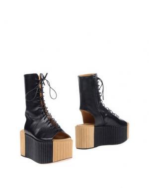 Полусапоги и высокие ботинки PETAR PETROV. Цвет: черный