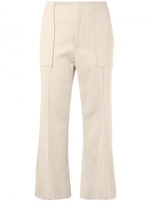 Укороченные расклешенные брюки Bassike. Цвет: коричневый