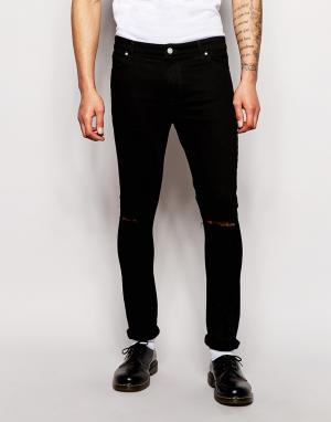ASOS Ультразауженные джинсы скинни с рваными коленями. Цвет: черный