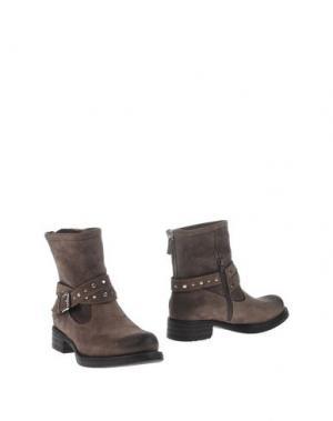 Полусапоги и высокие ботинки UNISA. Цвет: хаки