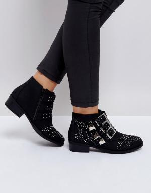 Truffle Collection Ботинки с отделкой заклепками и пряжками. Цвет: черный