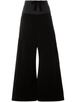 Расклешенные брюки Ter Et Bantine. Цвет: чёрный