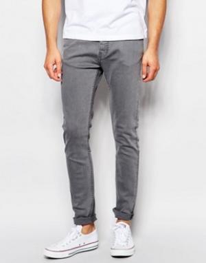 LDN DNM Серые выбеленные джинсы с покрытием. Цвет: серый