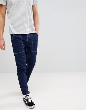 ASOS Суженные книзу джинсы из переработанного хлопка. Цвет: синий