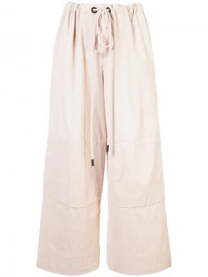 Экстра-широкие брюки Osklen. Цвет: коричневый