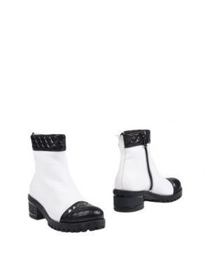 Полусапоги и высокие ботинки HÉCOS. Цвет: белый