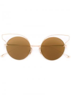 Солнцезащитные очки в круглой оправе Dita Eyewear. Цвет: металлический