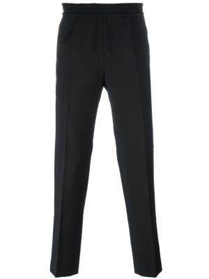Зауженные брюки Paolo Harmony Paris. Цвет: синий